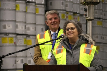 """Idaho governor C.L. """"Butch"""" Otter listens as Acting Assistant Secretary for Environmental Management Sue Cange addresses guests at the AMWTP Retrieval Completion Celebration on Thursday, March 2."""