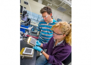 Dr. Adam Weber oversees the work of intern Sara Kelly at Lawrence Berkeley National Laboratory in California.  Dr. Weber was recently named one of the winners of the Presidential Early Career Awards for Scientists and Engineers. | Photo by Roy Kaltschmidt, Lawrence Berkeley National Laboratory