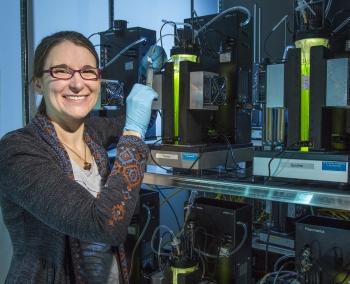 "Molecular biologist Dr. Amanda Barry at Los Alamos National Laboratory's environmental photobioreactor matrix, which simulates microalgal biofuel pond conditions. <a href=""/node/1143116"">Algal biofuels have big potential</a> for America's clean energy future. | <a href=""https://www.lanl.gov/"">Los Alamos National Laboratory</a> photo"