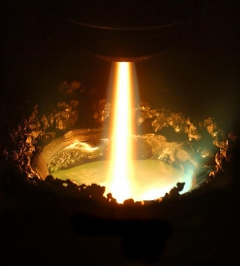 The plasma torch in the Retech plasma furnace is one tool used in Materials Preparation Center to create ultra-high purity metal alloy samples, particularly rare-earth metals, located at the Ames Lab. | Photo Courtesy of the Ames Lab Flickr