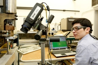 ORNL researcher Jian Chen works with the prototype weld inspection system licensed by Tennessee-based APLAIR Manufacturing Systems.