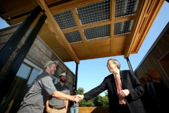 On Friday, Sept. 30, 2011, U.S. Department of Energy Secretary Steven Chu spoke with Jeffrey Tiller, left, and David Lee, right, members of Appalachian State's Solar Decathlon team. | Credit: Stefano Paltera/U.S. Department of Energy Solar Decathlon