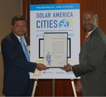 DOE Acting Under Secretary Dr. Arun Majumdar and Philadelphia Mayor Michael Nutter hold a Philadelphia Proclamation naming April Solar Energy Month. | Department of Energy Image | Photo by Susan Carollo, Contractor | Public Domain |