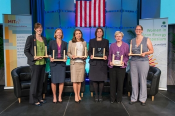 The hallmark of the 2013 Women in Clean Energy Symposium was the Clean Energy Education and Empowerment (C3E) awards ceremony, recognizing six women for their leadership and mentorship in clean energy fields. C3E award recipients (left to right): Kristen Graf, Kirstin Gunderson, Milo Werner, Rebecca Stanfield, Maxine Savitz (C3E 2013 Lifetime Achievement Award recipient), Erica Mackie. Not pictured: Katherine Lucey.   Photo by Justin Knight.