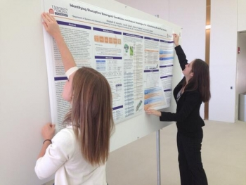 Setting up for the annual poster competition highlighting climate change-related research led by female graduate students from across the country. | Photo courtesy of the MIT Energy Initiative.