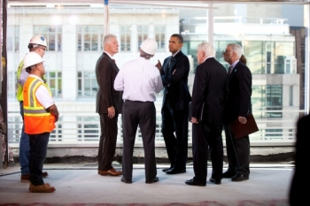 President Barack Obama and former President Bill Clinton take a tour of the upgrades of the Transwestern Building in Washington, Dec. 2, 2011. | Official White House Photo by Lawrence Jackson.
