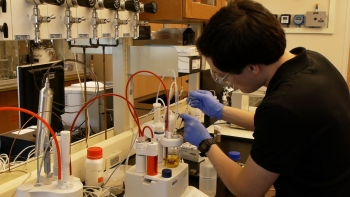 Jonathan Peters, a researcher at RTI International (an ARPA-E awardee), characterizes the water content of a bio-oil sample. | Courtesy of RTI International.