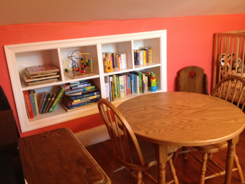 Pictured here is the knee wall in Seth Budick's daughter's room. While insulating behind the knee wall, Budick and his wife took advantage of the construction and added a built-in shelf -- an improvement that increased the room's comfort and storage.   Photo courtesy of Seth Budick.