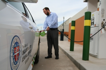 Andy Mitchell, Public Works Project Manager for the City of Oklahoma City, refills a vehicle at the new fast-fill CNG fueling station located at the city's main maintenance facility.   Courtesy of the City of Oklahoma City.
