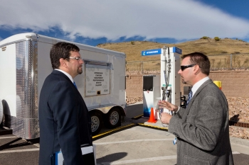 Keith Wipke of NREL discusses NREL's new hydrogen station and the HyStEP device being used to test it with David Friedman, Deputy Assistant Secretary of Energy Efficiency and Renewable Energy at the DOE. | Photo courtesy of NREL