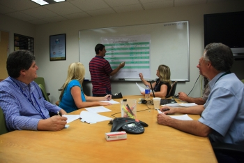 Members of the Carlsbad Technical Assistance Contractor discuss audit criteria for quality assurance implementation.