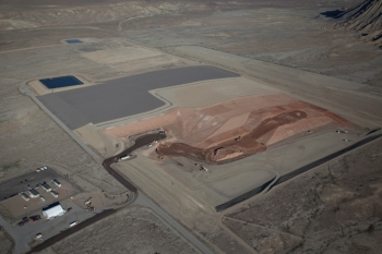View of the Crescent Junction disposal cell, looking northwest. From center left to right, the photo shows final cover, interim cover, tailings, and excavated cell ready to be filled.