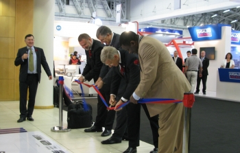 Deputy Secretary Poneman joins with officials from South Africa's energy sector to cut the ribbon at POWER-GEN Africa 2014 in Cape Town, South Africa.   Photo courtesy of the Energy Department.