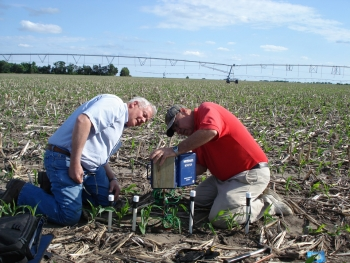At the University of Nebraska-Lincoln, state energy and extension staff are teaching farmers to use modern sensors to improve irrigation management. In this picture, Darrel Siekman and Gary Zoubek install Watermark Sensors and a data logger. | Photo courtesy of the University of Nebraska.