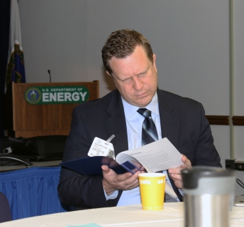 Dr. David Danielson, Assistant Secretary for Energy Efficiency and Renewable Energy, reads an energy open data pamphlet during the networking breakfast before the first-ever Energy Open Data Roundtable on April 29 in Washington, D.C. | <em>Photo by Mike Mueller for the Energy Department</em>