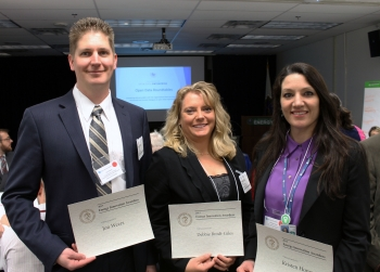 Jon Weers (left), Debbie Brodt-Giles (center), and Kristen Honey were among the 16 recipients of Energy Innovation Awards at the networking breakfast before the first-ever Energy Open Data Roundtable on April 29 in Washington, D.C. | <em>Photo by Mike Mueller for the Energy Department</em>