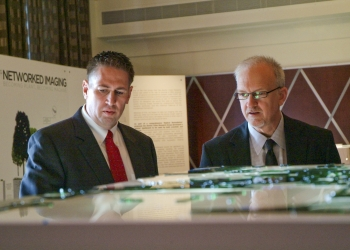 Senior Advisor for Environmental Management David Huizenga (right) and Paducah Site Lead Reinhard Knerr look at a three-dimensional model of the Paducah site's groundwater system. University of Kentucky College of Design students assembled the model for the Paducah Gaseous Diffusion Plant Citizens Advisory Board. The model was displayed at the April 18 Site-Specific Advisory Board Chairs Meeting in Paducah, where Huizenga spoke before taking his first tour of the Paducah site.