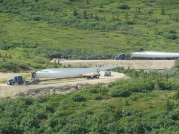Wind turbine blades are transported up the 10-mile-long, narrow dirt road to the Eva Creek Wind Farm site. | Photo courtesy of Golden Valley Electric Association