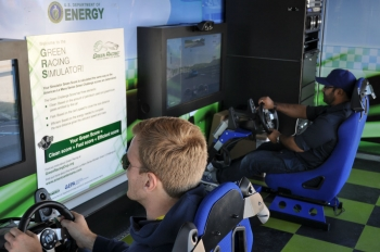 Race fans drive the Green Racing Simulator at the Rolex 24 at Daytona.  The simulator was developed at Argonne National Laboratory and is now operated by Oak Ridge National Laboratory. | Photo by Natalie Committee, Energy Department