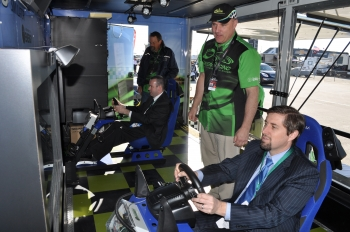 Bioenergy Technologies Office Director Jonathan Male (left) and Office of Energy Efficiency and Renewable Energy Principal Deputy Assistant Secretary Michael Carr drive the Green Racing simulator on Friday. | Photo by Natalie Committee, Energy Department