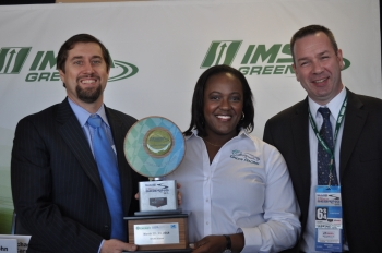 Office of Energy Efficiency and Renewable Energy Principal Deputy Assistant Secretary Michael Carr (from left), Environmental Protection Agency Region IV Administrator Heather McTeer Toney, and Bioenergy Technologies Office Director Jonathan Male pose with the Green Racing Challenge award. | Photo by Natalie Committee, Energy Department