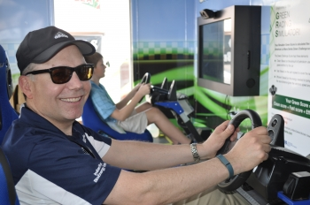Dan Cummings, President of INEOS New Planet BioEnergy, drives the Green Racing simulator on Friday. | Photo by Natalie Committee, Energy Department