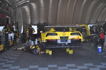 A crew works on the Chevrolet Corvette at the 12 Hours of Sebring in Florida. The GT Le Mans class car runs on E85 ethanol.  | Photo by Natalie Committee, Energy Department