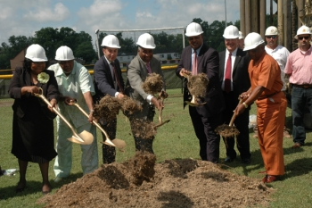 Birmingham, Alabama Mayor William A. Bell, Sr., City officials, and DOE representatives at the groundbreaking of an energy efficient HVAC system.