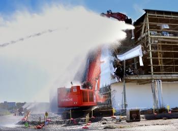 Workers begin demolishing the K-31 Building.