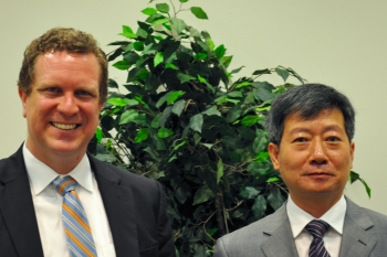 David Danielson (left), Assistant Secretary for Energy Efficiency and Renewable Energy, stands with Liang Zhipeng, Deputy Director General of the Department of New and Renewable Energy for China's National Energy Administration, at the fourth U.S.-China Renewable Energy Industries Forum in Washington, D.C.   <em>Photo by Josh Harmon</em>