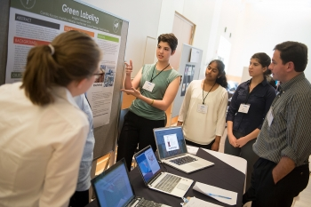A student participating in the Imagine Tomorrow competition explains her team's idea for green labeling. | Energy Department photo