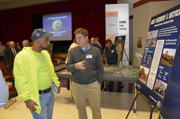 Caleb Miller (right) of EM contractor Fluor-BWXT Portsmouth talks with a visitor about asset recovery and recycling as part of cleanup operations underway at the Portsmouth Site.