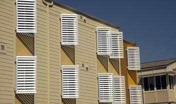 Sunlight reflects off the metal window sun shields on the Ramble apartments at West Village at UC Davis in Davis, California.   Photo by Greg Urquiaga /UC Davis, NREL 20240
