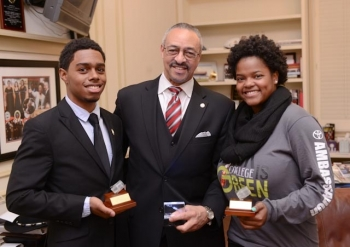 President Carlton Brown of Clark Atlanta University pictured here with winning students junior Jules Henry (Electrical Engineering/Computer Science) and sophomore KeAndra Goodman (Electrical Engineering/Physics).