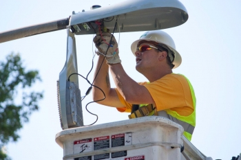A worker installs energy efficient lights as part of the Smart Lights for Smart Cities program. | Photo courtesy of Mid-America Regional Council.