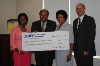Savannah River Remediation presents a $10,000 to South Carolina State University  to support its Nuclear Engineering Program. In the photo, from left: Kayla Miller, Savannah River Remediation Procurement Department and South Carolina State University 2010 graduate; Dr. John Corbitt, Acting Chairman of the South Carolina State University Board of Trustees; Dr. Cynthia Warrick, Interim South Carolina State University President; and Dave Olson, Savannah River Remediation President and Project Manager.