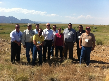 Senior Advisor for Environmental Management David Huizenga, fifth from left, and EM Office of External Affairs Director Paul Seider, first from left, stand for a photo with leaders and staff members of the Tribal Nations while on a tour of the Rocky Flats site following the Tribal Leader Dialogue in Denver on Tuesday.