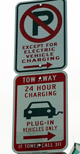 Street signage for Washington, DC's first electric vehicle charging station located on the northwest corner of the intersection of U and 14th streets.   Department of Energy Photo  