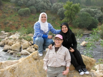 Eileen Vergino, standing, at a water quality workshop she helped lead in Jordan with her colleagues from Iraq.