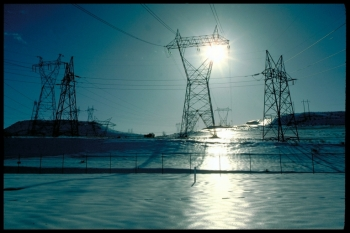 Electrical transmission lines cross a snow-covered field in Dalles Dam, Oregon. | Energy Department photo.
