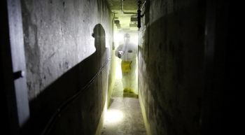 A radiation control technician surveys the radiation levels in the basement level of the F Reactor.