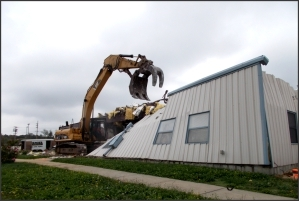A building is demolished at the Weldon Spring, Missouri, Site.