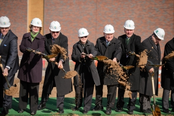 From left to right: Congressman Rogers, Senator Stabenow, Deputy Under Secretary for Science and Energy Dr. Michael Knotek, President Lou Anna Simon of Michigan State University, Senator Levin, and Chief of Staff to Governor Rick Snyder Dennis Muchmore break ground on FRIB. Photo courtesy of Michigan State University.