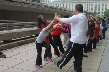In addition to hosting the vehicles education exhibit at the White House, Energy Department employees participated in many activities as part of Take Our Daughters and Sons to Work Day - like the fitness presentation shown above.   Energy Department file photo.
