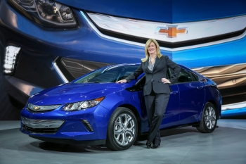 Pamela Fletcher, GM Executive Chief Engineer for Electrified Vehicles, poses with the 2016 Chevrolet Volt at the 2015 North American International Auto Show | Photo Courtesy of General Motors, Steve Fecht.