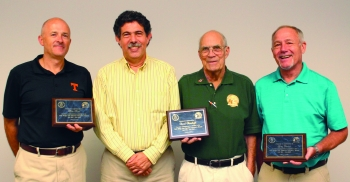 Dave Adler, ORSSAB's Alternate Deputy Designated Federal Officer, second from left, presented plaques of appreciation to outgoing board members Mike Ford, left, Dave Hemelright, and Greg Paulus, right.