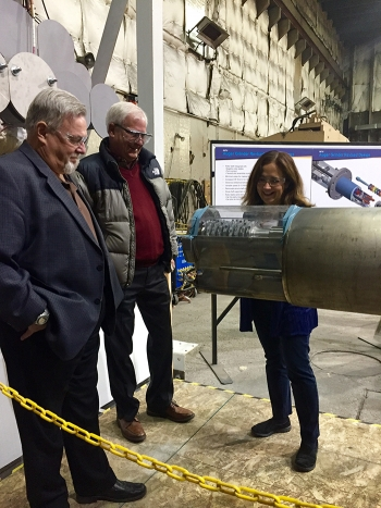 Mike Wiemers, an IWTU technical expert with contractor Fluor Idaho, center, shows the redesigned auger-grinder to EM Associate Principal Deputy Assistant Secretary Frank Marcinowski, left, and EM Assistant Secretary Monica Regalbuto.