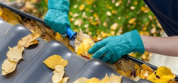 Cleaning your gutters will help prevent ice dams that can cause leaks and water damage. | Photo courtesy of ©iStockphoto.com/KatarzynaBialasiewicz