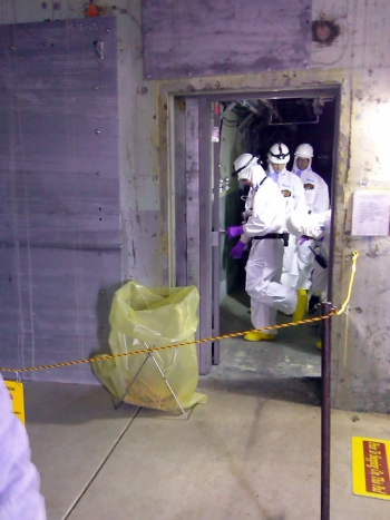 A safety team enters the H-Reactor for its initial safety evaluation and to verify conditions.