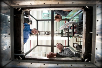 NREL's Large-Volume Battery Calorimeter has the highest-capacity chamber in the world for testing of this kind. From bottom clockwise:NREL researchers Matthew Keyser, Dirk Long & John Ireland | Photo Courtesy of Dennis Schroeder